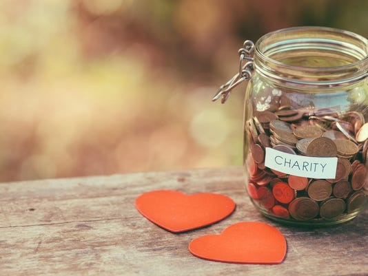 Glass jar for charity and two heart shapes