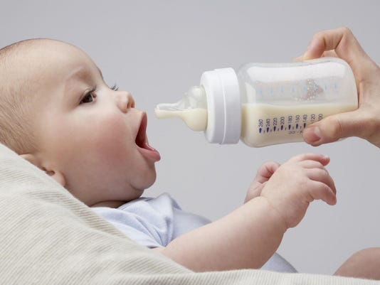 A baby being fed a bottle