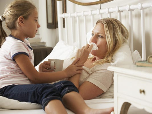 Daughter Visiting Sick Mother In Bed