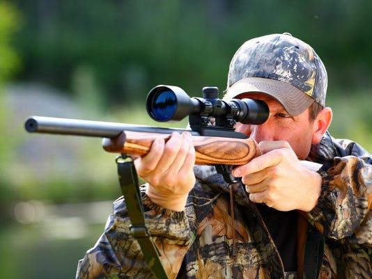 Closeup of hunter ready to aim at animal