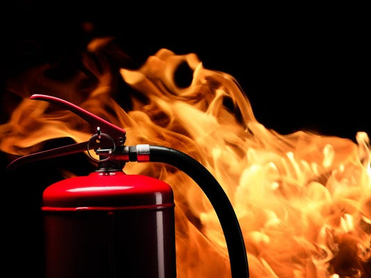 fire-extinguisher on flame background