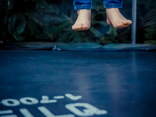 Legs floating in the air after jumping on the trampoline