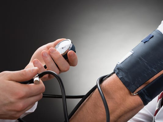 Doctor Checking Blood Pressure Of A Patient