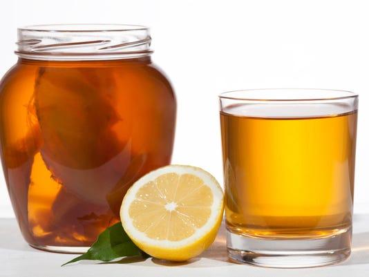 Kombucha superfood pro biotic beverage in glass with lemon