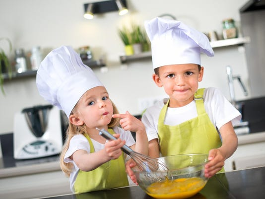 young kids happy childrens family preparing funny cake kitchen home