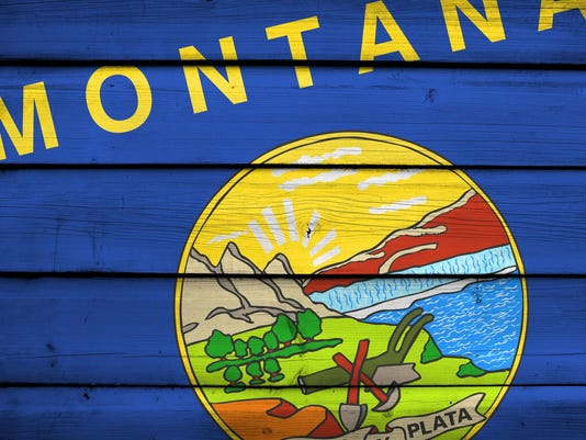 Montana State Flag on wood background