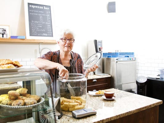 Senior working in coffee shop