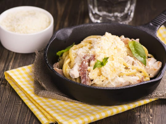 Scrambled eggs help create a lush texture for creamy pasta with bacon.