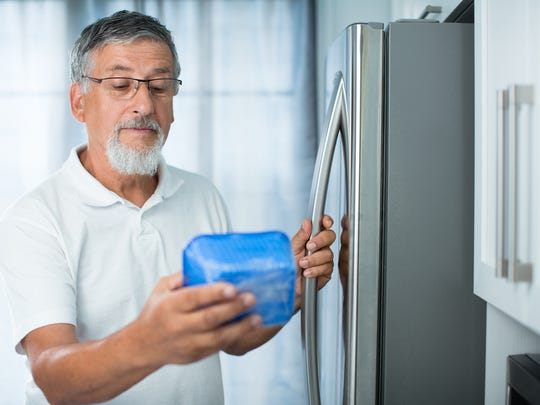 This man looks a lot like Robert De Niro —and the body of his standard depth fridge is sticking out at least six inches from the cabinetry in his kitchen.