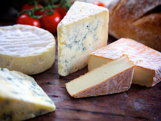 Cheese develops flavor through multiple phases of its production process