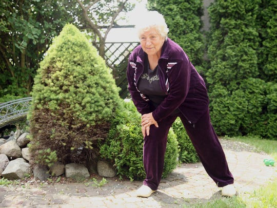 overweight senior woman exercising