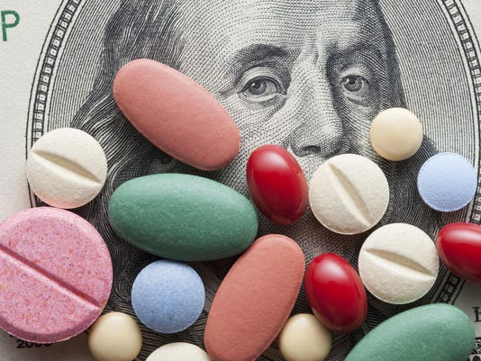 Cost of Healthcare. Pills on US dollars.