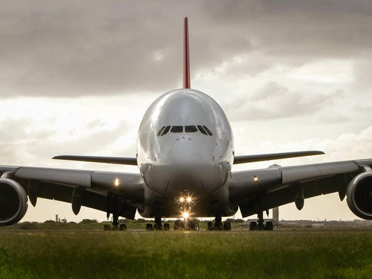 Airbus A380 airliner under cloudy skies