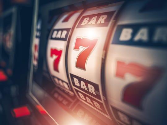 A slot machine coming up sevens.