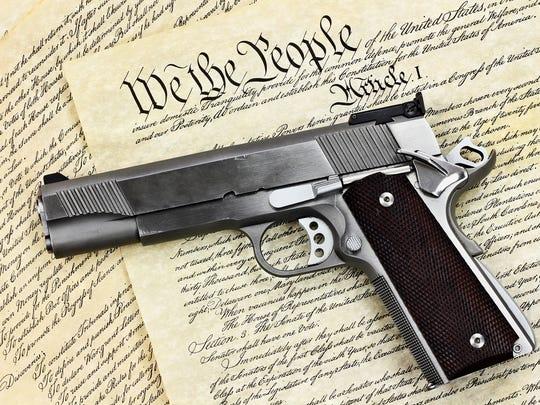 Handgun laying on the Constitution