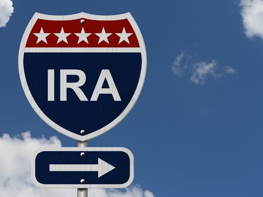"An interstate road said that says ""IRA""; the letters IRA are in white against a blue background, and on top of the there's a row of five white stars on a red background. Under the word IRA, with an arrow pointing to the right"