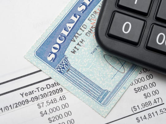 Social Security card with calculator and statement.