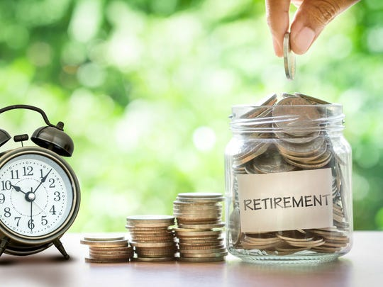 Jar of retirement savings next to an alarm clock