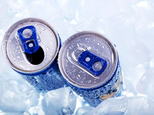 Two soda cans in ice.
