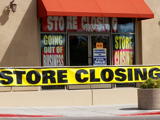 "Storefront with ""Store Closing"" signs in window"