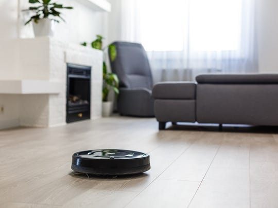 A robotic vacuum cleaner cleaning a living room floor