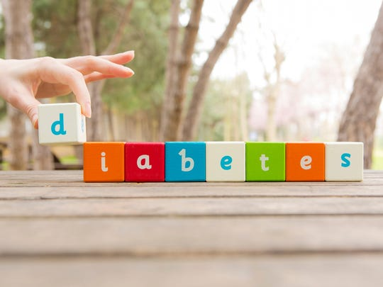 """The word """"diabetes"""" spelled out with wooden letter blocks"""