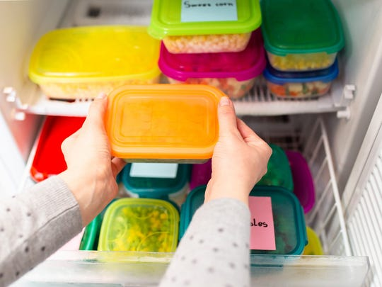 A pantry full of food storage containers.