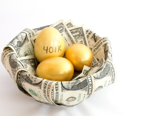 Nest of dollar bills with three gold eggs, one with 401k written on it.