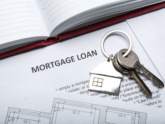 House keys on top of mortgage loan documents.