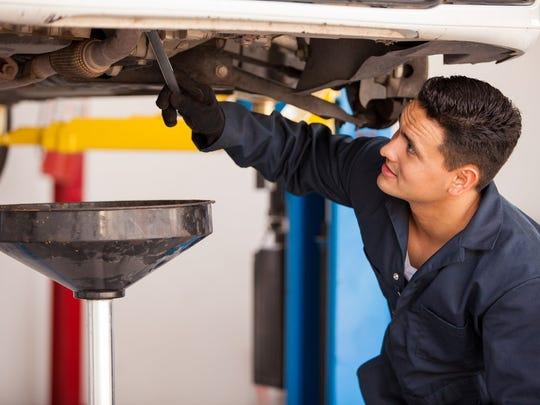 A man performing car maintenance