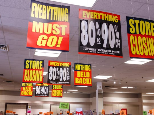 Several store closure signs.
