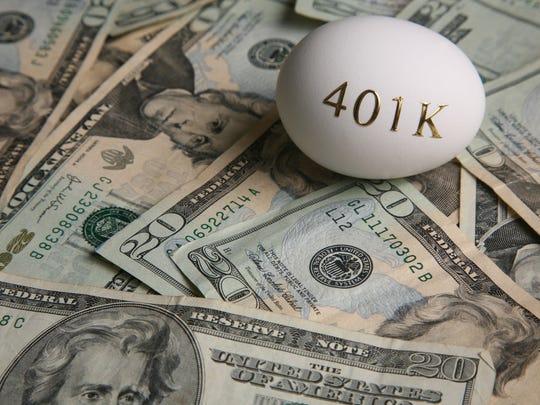 401k egg on top of twenty dollar bills.
