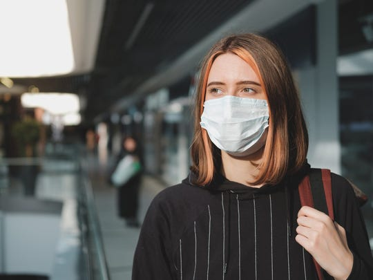 Woman with face mask at mall
