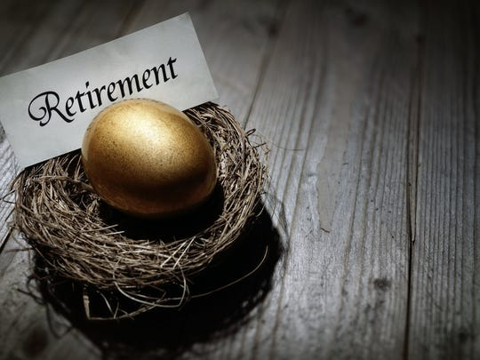 Golden egg in a nest with the word retirement