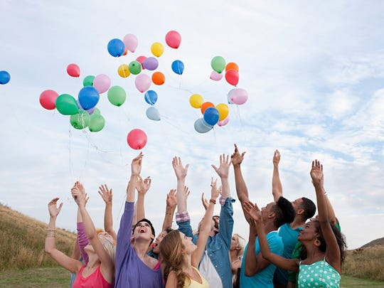 Group of people releasing balloons