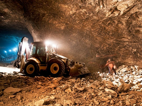 An excavator operating in a gold mine.