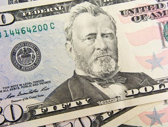 A up-close view of a fifty dollar bill.