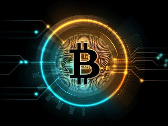 A digital circle around the symbol for bitcoin.