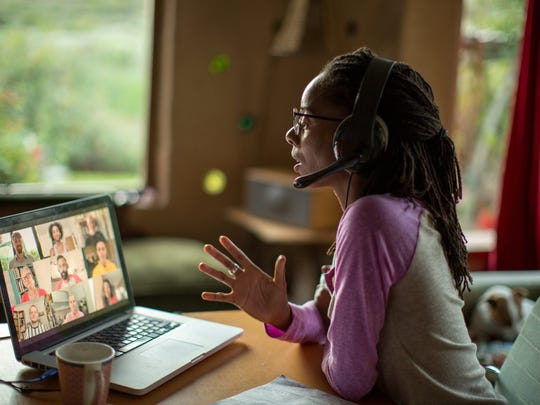 A woman working from home having a video meeting.