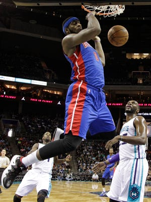 Detroit Pistons center Andre Drummond (0) dunks as the Charlotte Hornets' Al Jefferson in Charlotte, N.C., on Oct. 15, 2014.