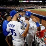 American League's Salvador Perez, of the Kansas City Royals, left, congratulates teammate Eric Hosmer, of the Kansas City Royals, for Hosmer's MVP award in the MLB baseball All-Star Game, Tuesday, July 12, 2016, in San Diego. The American League won 4-2. (AP Photo/Lenny Ignelzi)