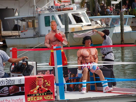 Rocky, a.k.a. John Ritchie, takes a break between rounds against an opponent known as Vlad the Invader, a.k.a Mr Putin, at theannual quirky Goodland boat parade.