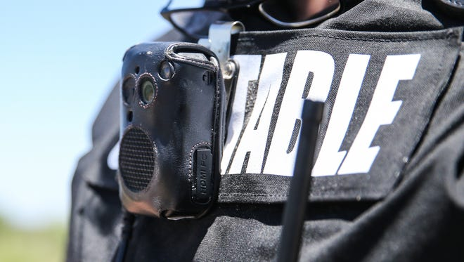 Tom Green County Constable Randy Harris, Precinct 4, wears an older model body camera during an eviction Wednesday, June 28, 2017.