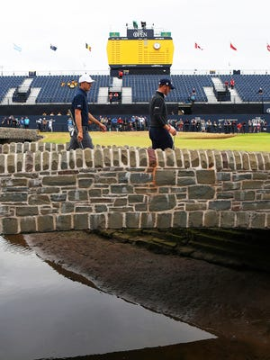 Jordan Spieth, left, and Justin Thomas walk to the 18th green during a practice round for the 147th Open golf Championship at Carnoustie golf club, Scotland, Tuesday.