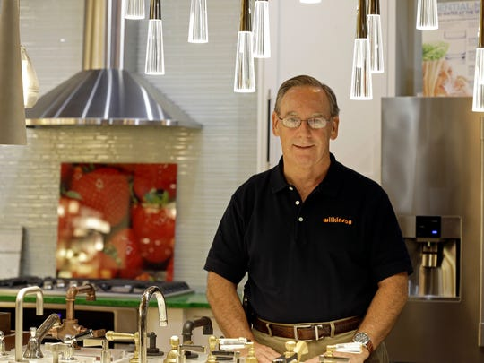 In this Friday, Oct. 21, 2016, photo, Ken Wertz, president of Wilkinson Supply, poses for a picture in the company's showroom that sells kitchen, bathroom, plumbing and decorative items, in Raleigh, N.C. Small businesses such as Wilkinson's Supply are preparing for an impending change in overtime.