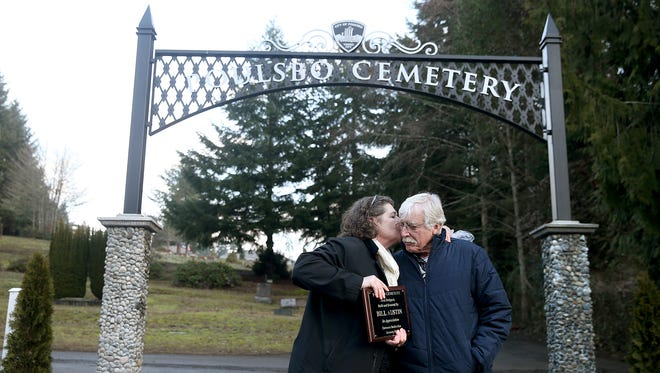Poulsbo Mayor Becky Erickson gives Bill Austin a kiss after presenting hm with a plaque Tuesday at the dedication ceremony for the new Poulsbo Cemetery entrance. Austin designed and donated the archway entrance.