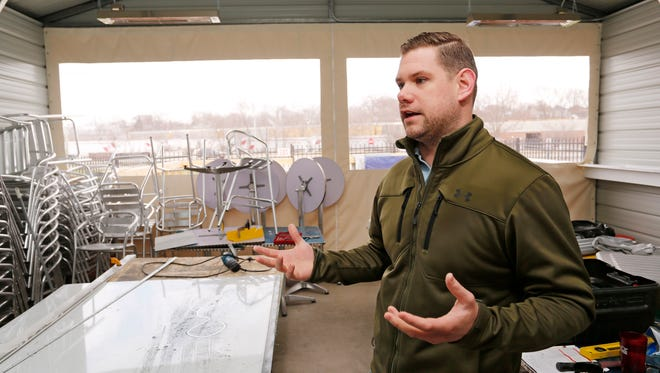 Owner Jason Conley talks Wednesday, April 4, 2018, about the new patio space under construction at the Tick Tock Tavern, 1816 N. 9th Street in Lafayette. Conley said the patio, which will be heated, will have seating for 59 people. Plans are for the patio to be completed by the end of the month.