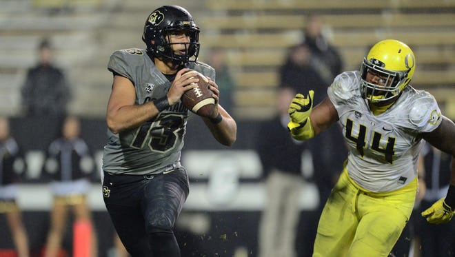 Oct 3, 2015; Boulder, CO, USA; Oregon Ducks defensive lineman DeForest Buckner (44) chases Colorado Buffaloes quarterback Sefo Liufau (13) late in the fourth quarter at Folsom Field. The Ducks defeated the Buffaloes 41-24. Mandatory Credit: Ron Chenoy-USA TODAY Sports