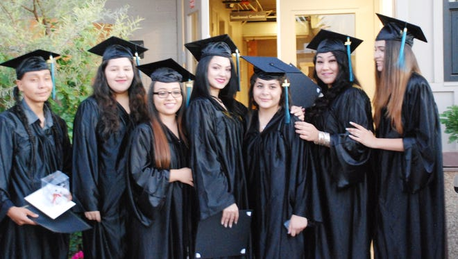 Students participate in a graduation ceremony for the Maricopa County for Adolescent Parents offered by Child and Family Resources, Inc.