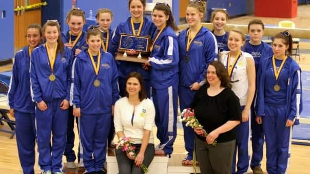 Members of the 2010 Waynesboro gymnastics team pose for a picture after winning the PA Classic Gold Division team championship.